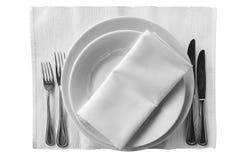 Platten mit Messern und Gabeln Isolierung Lizenzfreies Stockfoto