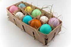 Plattenspeicher mit einheitsgerechten Adressen von zehn färbte Eier lokalisiert auf Weiß Lizenzfreie Stockbilder