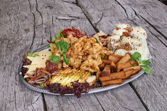 Platter of appetizers on wooden table Royalty Free Stock Photo