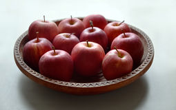 Platter of apples. Apples on the wooden and hand-made platter Stock Photography