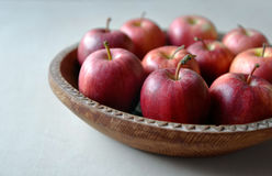 Platter of apples. Apples on the wooden and hand-made platter Royalty Free Stock Photography