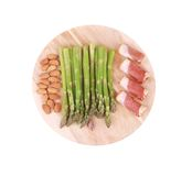 Platter with asparagus and prosciutto. Royalty Free Stock Photography