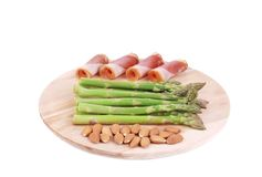Platter with asparagus and prosciutto. Royalty Free Stock Photo