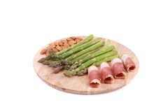 Platter with asparagus and prosciutto. Stock Photography