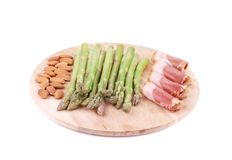 Platter with asparagus and prosciutto. Stock Image
