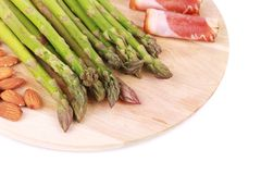 Platter with asparagus and prosciutto. Royalty Free Stock Image