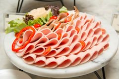 Platter of assorted cold cut slices. Stock Photography