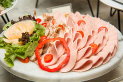 Platter of assorted cold cut slices. Stock Photos