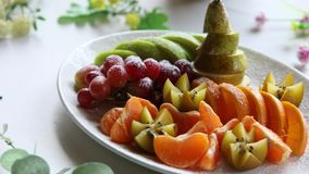 Platter of a assorted fresh fruit. Cut professionally stock video footage