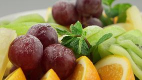 Platter of a assorted fresh fruits. In long white plate stock video