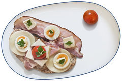 Sandwich With Bacon Rashers Egg Cheese Ham And Cherry Tomatos Served On Porcelain Platter Isolated On White Background. Sandwich with toasted Brown bread, Pork Stock Image