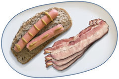 Platter with Bacon Rashers and Hot Dogs on Integral Bread Slice Royalty Free Stock Image