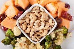 Platter of Cashews, Fruit, and Vegetables macro shot Royalty Free Stock Photos