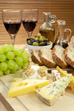 Platter of Cheese, Wine, Grapes, Olives, Bread. A platter of Mediterranean food including cheese, grapes, wine, bread, olives, olive oil and balsamic vinegar Royalty Free Stock Photography