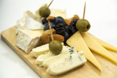 Platter of cheese on a wooden board Royalty Free Stock Photography