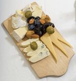 Platter of cheese on a wooden board Royalty Free Stock Image