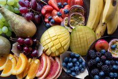 Platter of colourful fruit including mango, oranges, blueberries, bananas and pears. Platter of colourful fruit including mango, oranges, blueberries, bananas royalty free stock images
