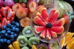 Platter of colourful fruit, sliced up. stock photos
