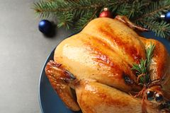 Platter of cooked turkey with Christmas decoration. On grey background, closeup royalty free stock photography