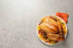 Platter of cooked turkey with garnish on grey background. Top view. Space for text royalty free stock images