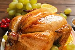 Platter of cooked turkey with garnish on table. Closeup royalty free stock images
