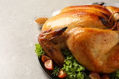 Platter of cooked turkey with garnish on table, closeup. Space for text royalty free stock photography