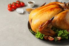 Platter of cooked turkey with garnish on table. Space for text. Platter of cooked turkey with garnish on table, closeup. Space for text royalty free stock photography