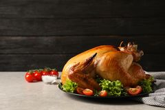 Platter of cooked turkey with garnish on table. Space for text stock image
