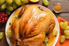 Platter of cooked turkey with garnish on table. Top view royalty free stock photos