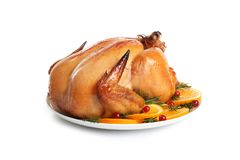 Platter of cooked turkey with garnish on white. Background stock images