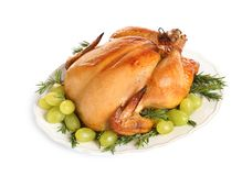 Platter of cooked turkey with garnish on white. Background stock photo