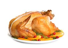Platter of cooked turkey with garnish. On white background stock photo