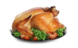 Platter of cooked turkey with garnish. On white background stock images
