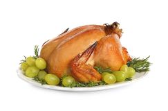 Platter of cooked turkey with garnish. On white background stock photography