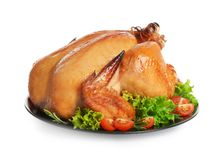 Platter of cooked turkey with garnish on white. Background royalty free stock photo