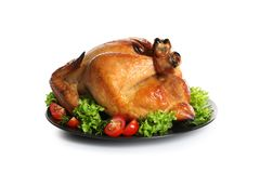 Platter of cooked turkey with garnish on white. Background royalty free stock photos