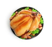 Platter of cooked turkey with garnish on white background. Top view stock photos