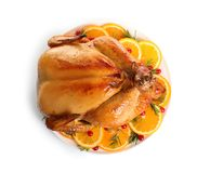 Platter of cooked turkey with garnish on white background. Top view royalty free stock photo