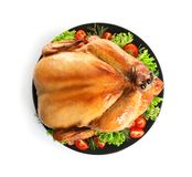 Platter of cooked turkey with garnish on white background. Top view stock images