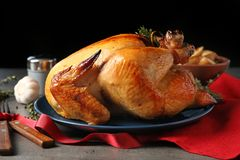 Platter of cooked turkey with rosemary served. On table royalty free stock photo