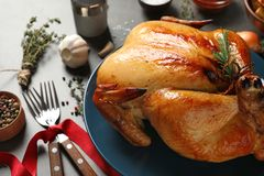 Platter of cooked turkey with rosemary on table. Closeup stock image