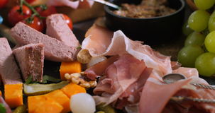 A platter of cured meat charcuterie, ham, salami, pate and cheese stock video