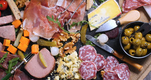 A platter of cured meat charcuterie, ham, salami, pate and cheese Royalty Free Stock Images