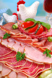 Platter of cured meat,ham and salami on eater table Stock Images