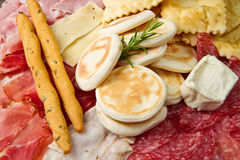Platter of cured meats, cheeses and fried dumpling Stock Photography
