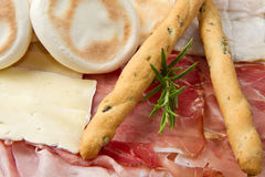 Platter of cured meats, cheeses and fried dumpling Royalty Free Stock Photos