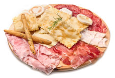 Platter of cured meats, cheeses and fried dumpling Royalty Free Stock Images