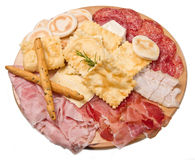 Platter of cured meats, cheeses and fried dumpling Royalty Free Stock Photo