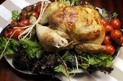 Scrumptious roast turkey chicken on platter royalty free stock images