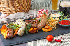 Platter of different grilled sausages Stock Photos